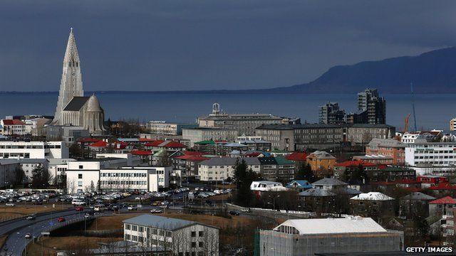 Buildings surround the Hallgrimskirkja church tower in the Icelandic capital Reykjavik on 7 April 2014
