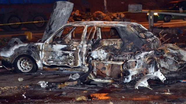 Burnt car at scene of Abuja bombing