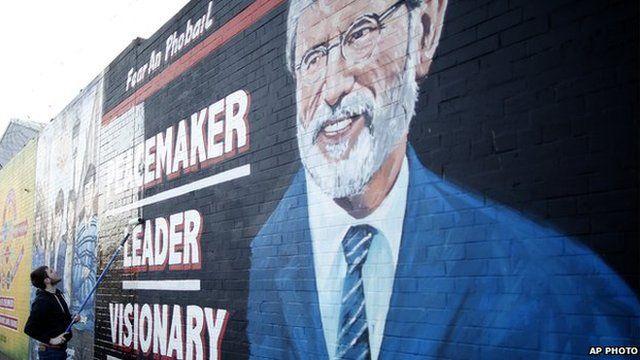 Man paints a mural of Gerry Adams in West Belfast