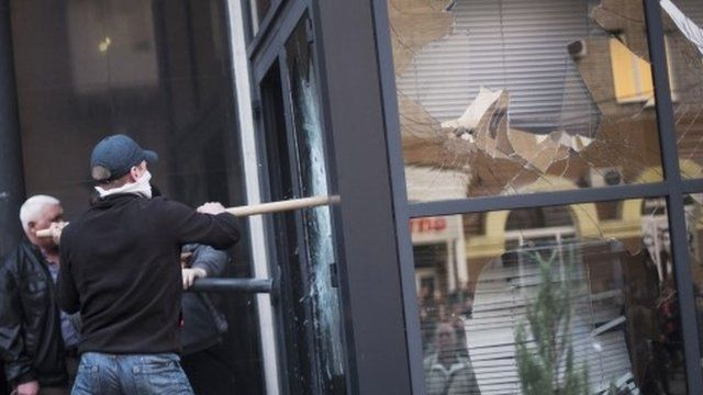 Activists breaking into a building in Donetsk