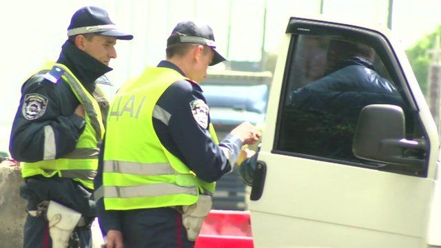 Police checking one driver's papers