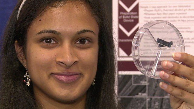 Eesha Khare holding up her a super-capacitor