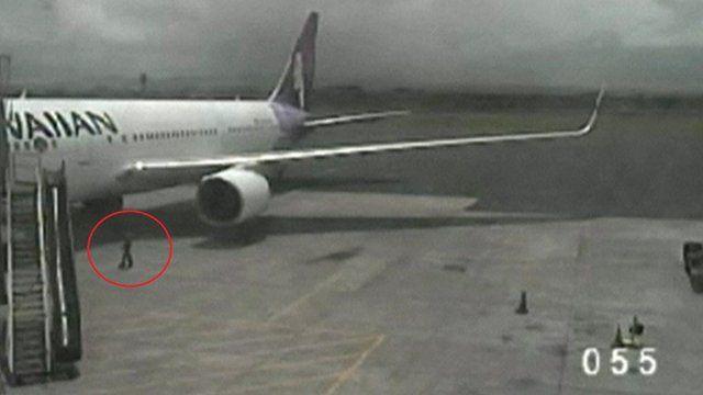 Yahya Abdi walks away from plane