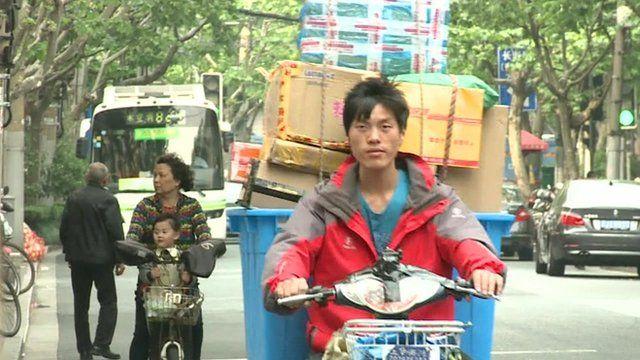 Man delivering parcels in China