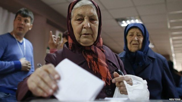 Two elderly women voting in Donetsk
