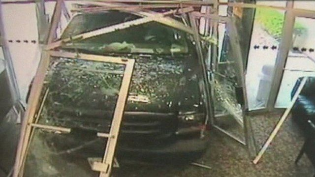 The truck smashing through the TV station's entrance