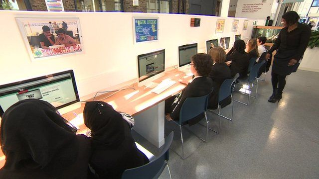 Classroom with young people doing coding