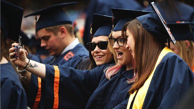 University students take a 'selfie' at graduation ceremonies