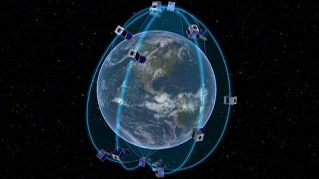 A graphic showing mini-satellites orbiting the Earth
