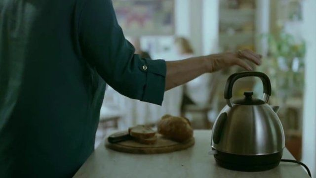 A woman and a kettle