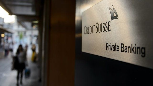 A sign of a Credit Suisse private banking branch is seen on May 19, 2014 in Geneva, Switzerland