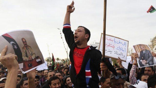 Men carrying pictures of former Libyan commander Major General Khalifa Haftar