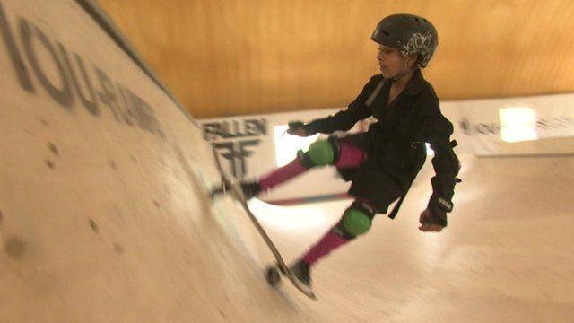 A girl skateboarding in Skateistan in Mazar-e-Sharif