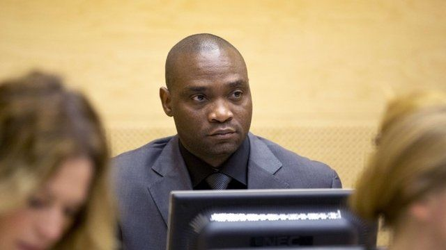 Germain Katanga sits during his trial at the International Criminal Court (ICC) in the Hague