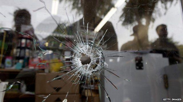 Bullet hole in shop window
