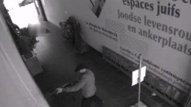 Gunman caught on CCTV