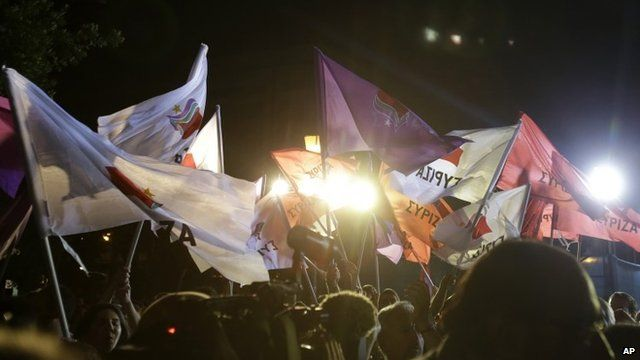Syriza supporters waving flags