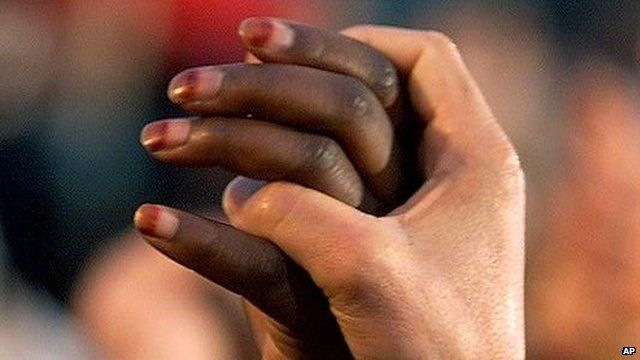 Hands of black and white people