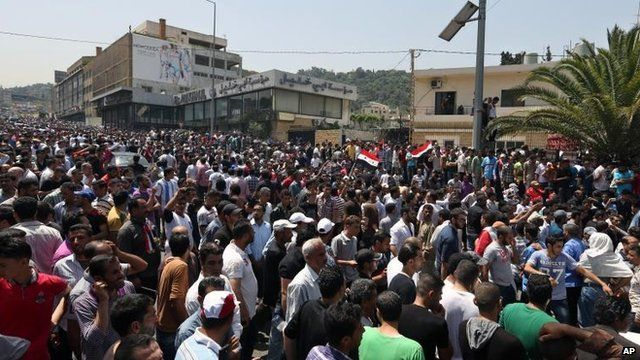 Syrians outside the Syrian embassy in Beirut