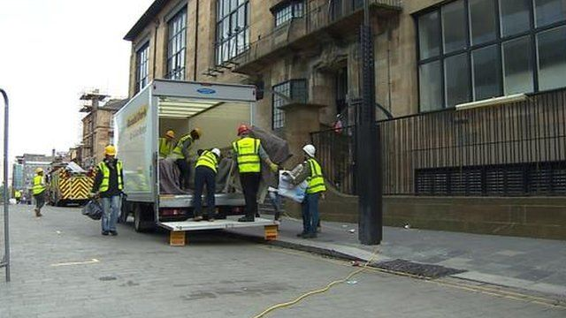 Workers retrieve items from the Charles Rennie Mackintosh building
