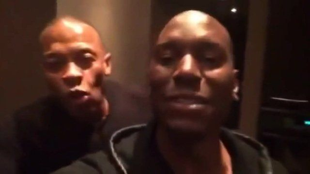 Still from video posted online shows Dr Dre (left) celebrating Apple deal