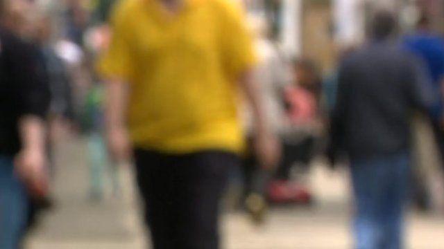 Obese man walking