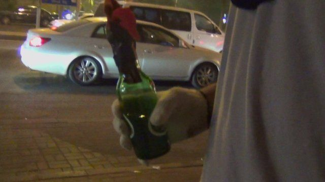 Protester holding Molotov cocktail