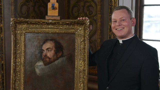 Father Jamie MacLeod with the Van Dyck art