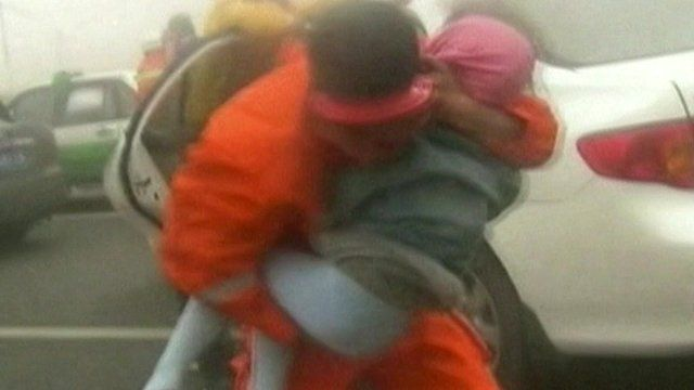 Rescuer carrying child