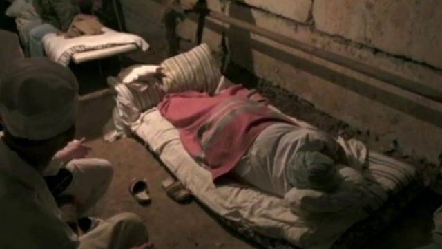 Civilians sleeping in the basement of a psychiatric hospital