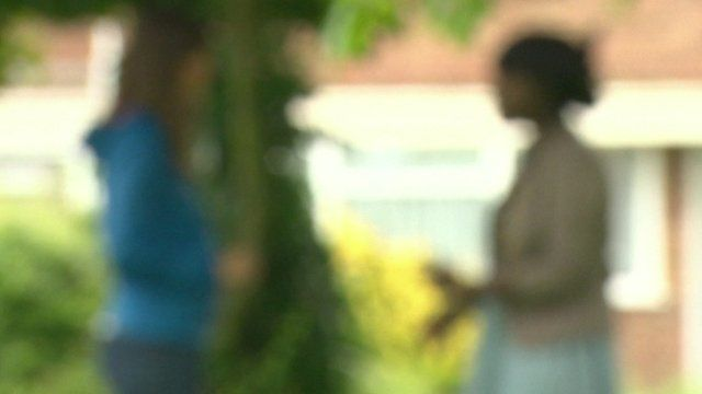 Blurred picture of woman who worked as slave talking to Jenny Hill
