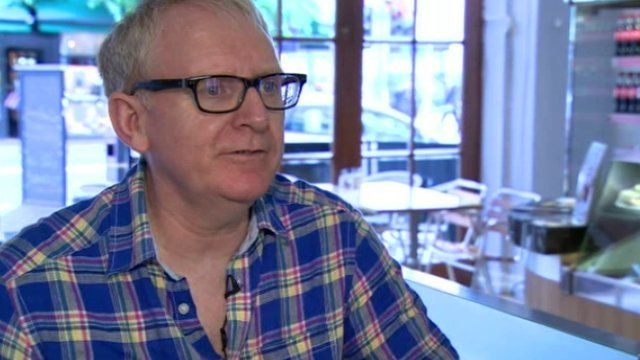 Café owner Tomas Morris believes the new bus lanes put people off coming into Belfast