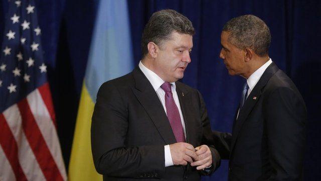 US President Barack Obama, right, meets with Ukraine president-elect Petro Poroshenko in Warsaw, Poland, Wednesday, June 4, 2014