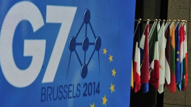 Flags are seen prior to the G7 summit at the European Council headquarters on June 4, 2014 in Brussels
