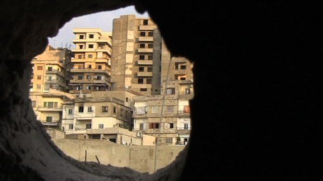 View through rubble onto buildings