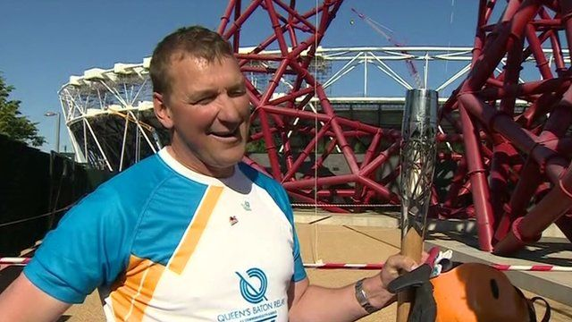 Sir Matthew Pinsent with the Queen's Baton