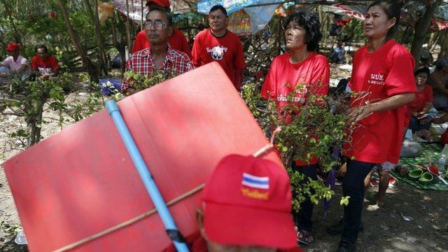 """Pro-government """"red shirt"""" supporters listen to their leader""""s speech inside their encampment in the suburbs of Bangkok May 20, 2014"""