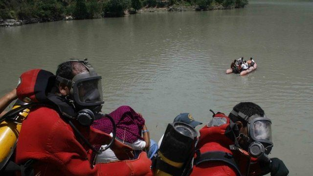 Rescue workers on the banks of the Beas river in Kullu valley