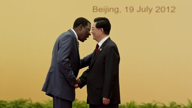 Former Chinese President Hu Jintao shakes hand with Benin's President Thomas Yayi Boni at the Great Hall of the People in Beijing on July 19, 2012.