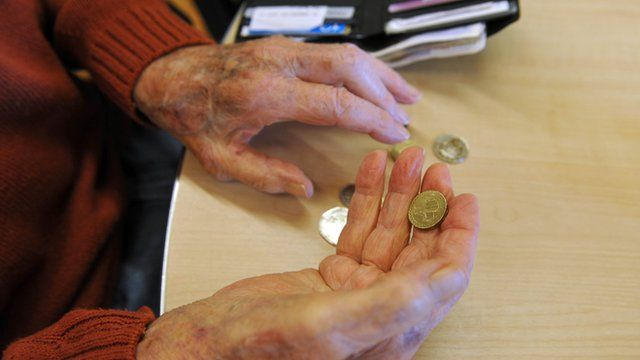 Elderly person handling money
