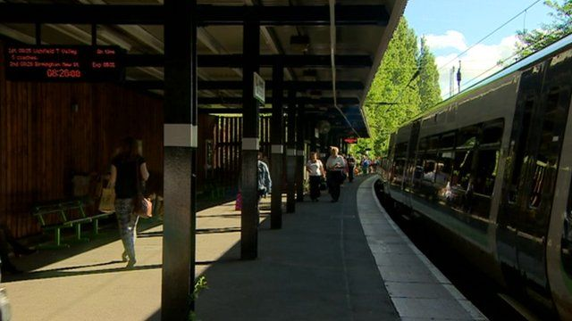 A train pulls in at a platform