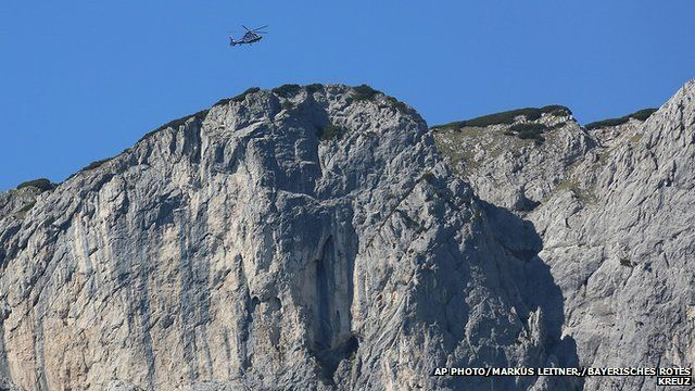 A helicopter flies above the Berchtesgaden Alps