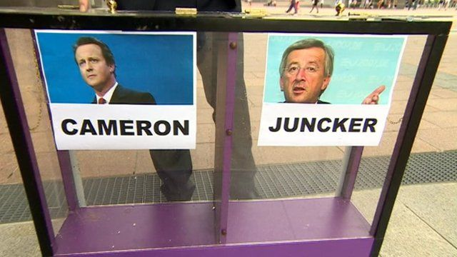 Cameron and Juncker images on mood box