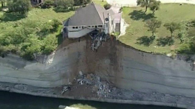 House hanging over a cliff