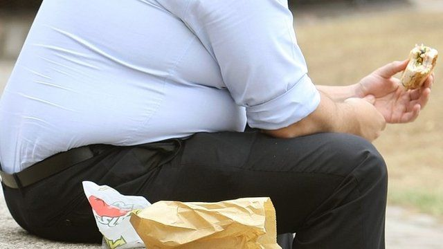 Man eating sandwich - file photo 28 May 2014