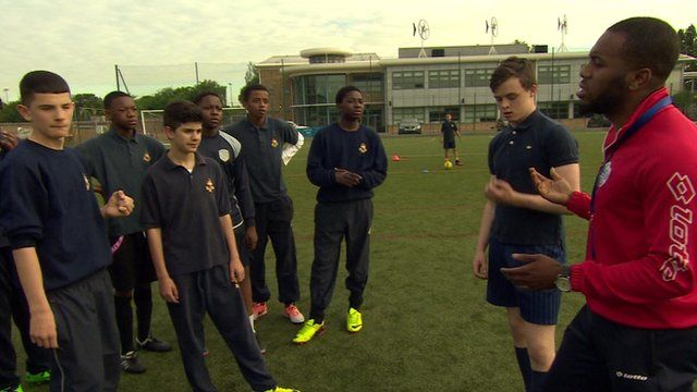 Pupils receiving football coaching