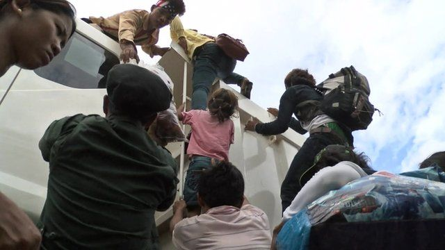 Workers climbing into truck