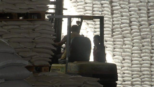Sacks of food piled inside World Food Programme warehouse in Damascus