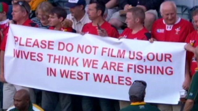 Wales rugby fans holding the banner at South Africa game