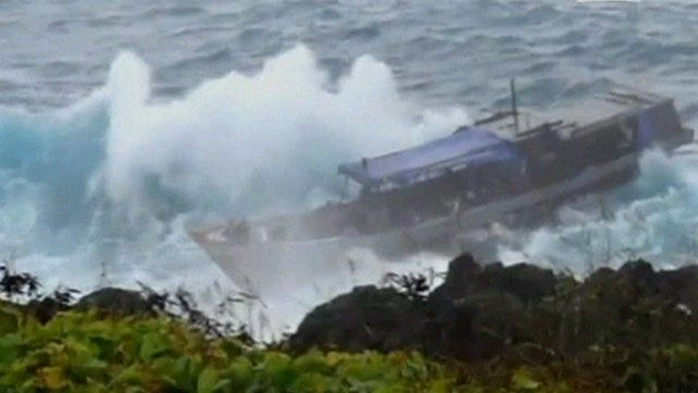 Ship next to Christmas Island coastline